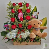 Arrangement of roses in scale and plush